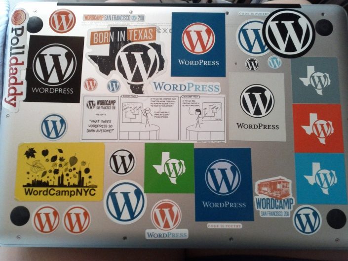 My work laptop proudly covered in WordPress stickers.